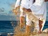bride-groom-kicking-barbados-beach-sand